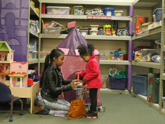 Antasha Wilson of Rochester plays with her niece, Sammiyah Jones, 4, in the Toy Library.