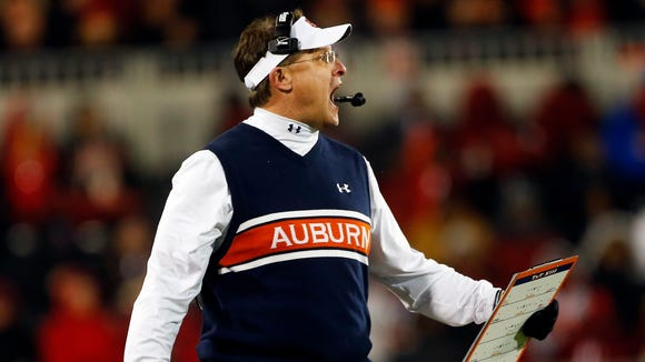 Auburn coach Gus Malzahn reacts in the second half of an NCAA college football game against Georgia Saturday, Nov. 15, 2014, in Athens, Ga. (AP Photo/John Bazemore)
