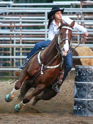Sartell barrel racer Erica Traut competes on her horse Rollin during a competition earlier this year.