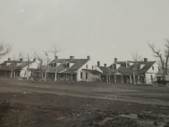 The Fort Shaw Officer Quarters circa 1917. The center building is being restored.