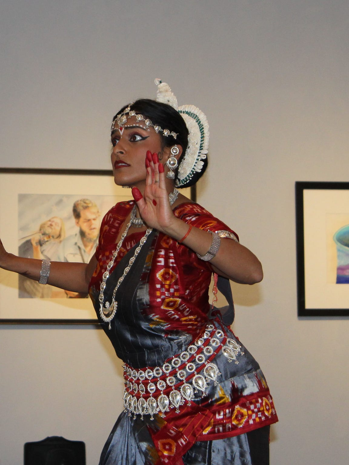 A dancer from the Indian Association of Dance performs a narrative about the Hindu god Krishna.