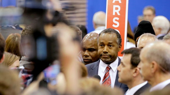 Ben Carson takes a question in the spin room after the Republican debate in Houston on Feb. 25, 2016.