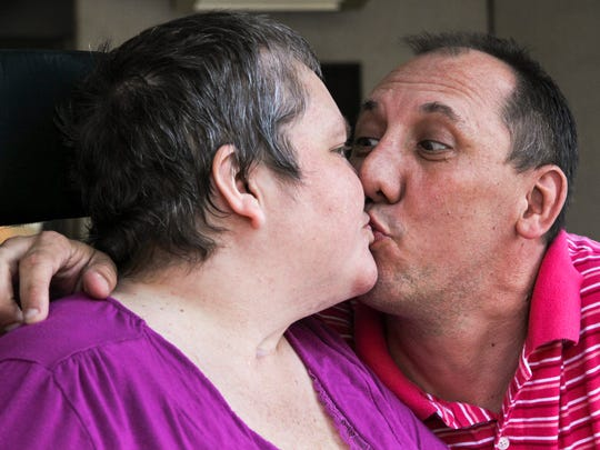 Rev. Gregg Loner, right, gets a kiss from his wife Dee Loner after her therapy at the Roger C. Peace Rehabilitation Hospital in Greenville.