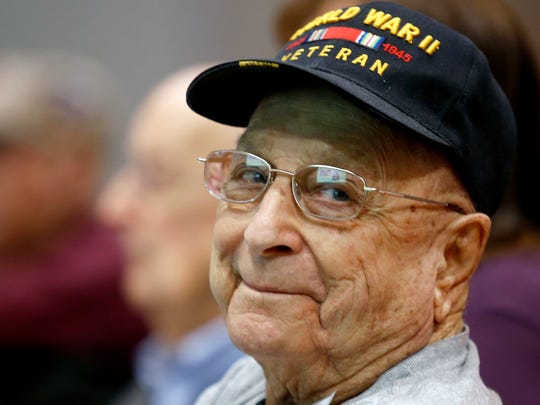 WWII Firmin J. Hingsbergen, 91, of Hamilton was one of about 75 veterans from the Cincinnati area who attended a luncheon and patriotic program sponsored by The Urology Group to honor veterans for the 75th anniversary of Pearl Harbor Wednesday December 7, 2016 at the Sharonville Convention Center Wednesday.