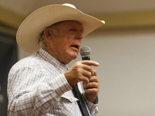 Cliven Bundy addresses those gathered for a political summit for the Independent American Party Saturday, Aug. 2, 2014, in St. George.