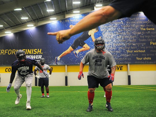 Sioux Falls Storm's Claude Jones, left, and Cory Johnsen, right, participate in a drill during practice on Tuesday, June 16, 2015, at the Sanford Fieldhouse in Sioux Falls.