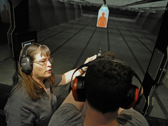 Instructor Karen Becotte teaches Christopher Ashton about firing his handgun on the range at Nashville Armory in this 2015 file photo.