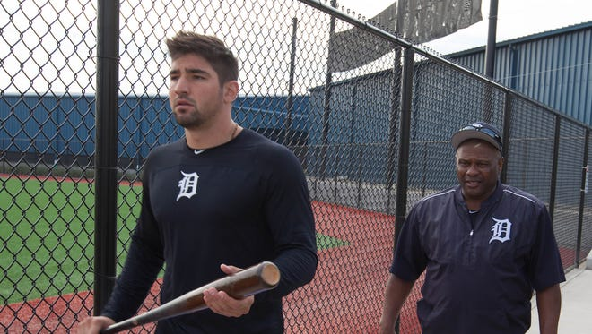 Tigers infielder Nick Castellanos and hitting coach after a batting cage session before the first full team workout in spring training on Feb. 18, 2017, at Publix Field at Joker Marchant Stadium in Lakeland, Fla.