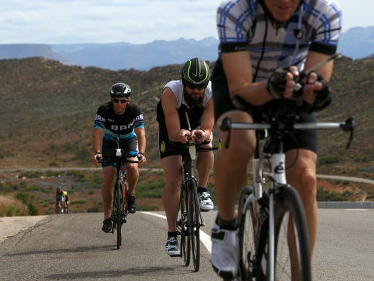 Participants in the Balanced Art Multipart triathlon camp take a training ride on a portion of the Ironman St. George course Friday, April 14, 2016.