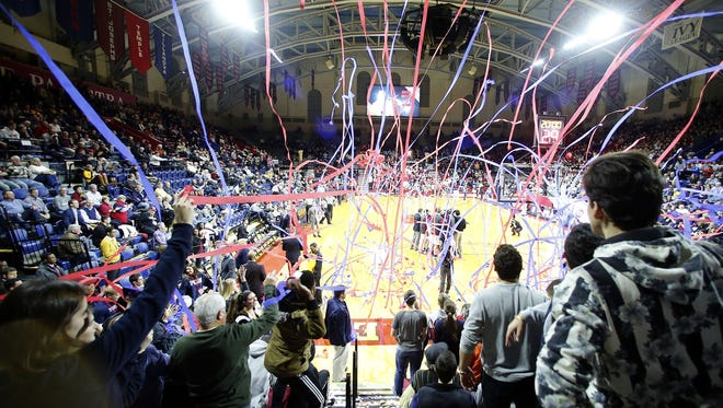 Penn students throw streamers on the court before a game against St. Joseph's at the Palestra in Philadelphia on Jan. 20, 2016.