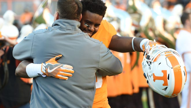 Tennessee defensive back Malik Foreman (13) greets Tennessee head coach Butch Jones during Senior Day presentations before the final game of the 2016 season against Missouri at Neyland Stadium on Saturday, Nov. 19, 2016.