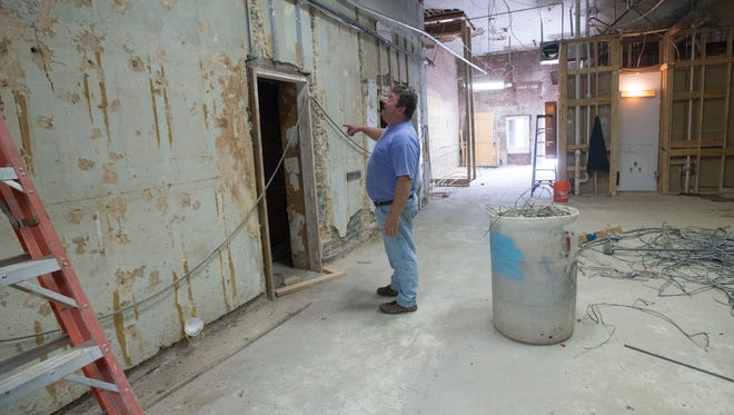 Tim Price, from Biggs Construction, works on demolishing the interior space of the former Consumer Credit Counseling Services of West Florida, building on Palafox Place. The building located at 14 Palafox Place is being turned into a cigar bar.