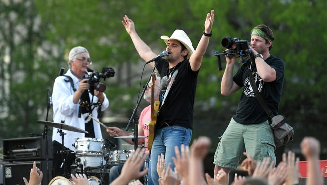 "Country music singer and Franklin, Tenn. resident Brad Paisley films a music video for his new song  ""Heaven South"" on the downtown Franklin square on Saturday, April 15, 2017."