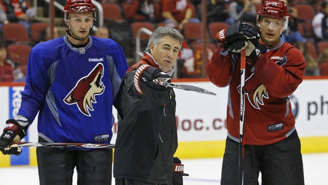 Arizona Coyotes head coach Dave Tippett gives directions during training camp.
