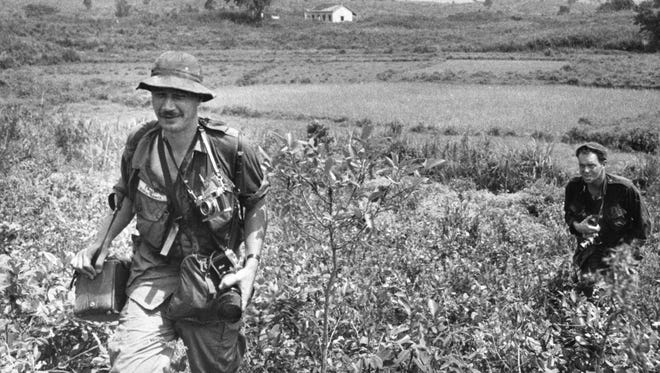 **FILE** Eddie Adams, foreground, covers action in South Vietnam in 1965 for The Associated Press.  Behind him is photographer George Sweers of the St. Petersburg (Fla.) Times.  PHotojournalist Eddie Adams died at his Manhattan, New York home from complications of amyotrophic lateral sclerosis, or Lou Gehrig's disease, Sunday, Sept. 19, 2004 said his assistant, Jessica Stuart. He was 71.