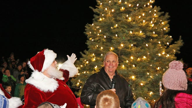 Santa and Ankeny Mayor Gary Lorenz light the tree during the annual Mayor's Tree Lighting on Friday, Dec. 1, 2017 at the Ankeny Market & Pavilion at 715 W. First St. featuring ice sculpture demonstration, children's craft, costumed characters, music, a visit from Santa and a fireworks finale.