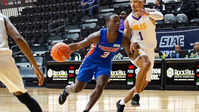 Savannah State guard Zion Williams (3) drives against Miles College in the quarterfinals of the 2020 Southern Intercollegiate Athletic Conference men's basketball tournament on March 4.  Miles won 85-64. The men's and women's basketball seasons for this school year are set to start Jan. 9.