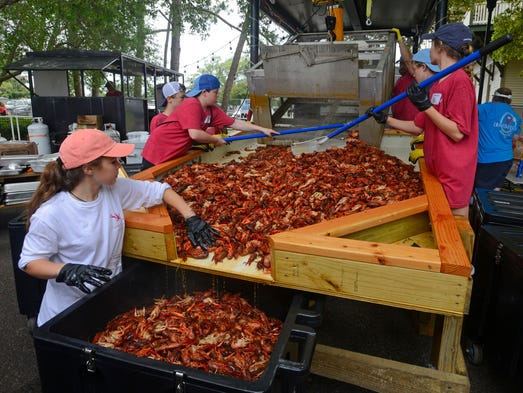 Fresh boiled crawfish are taken out of the boiler Saturday