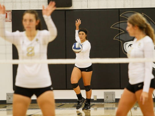 Butte College's Marissa Weber prepares to serve the