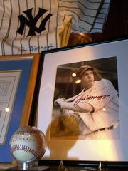 Joe DiMaggio memorbilia adorns the walls in one dining