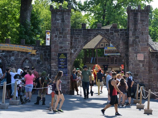 Patrons enter the gates to the Shire of Mount Hope in August on the first day of the 2015 Pennsylvania Renaissance Fair.