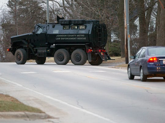 Johnson County's Mine Resistant Ambush Protected vehicle turns onto Benton Street after supporting a situation on Benton Drive Monday.