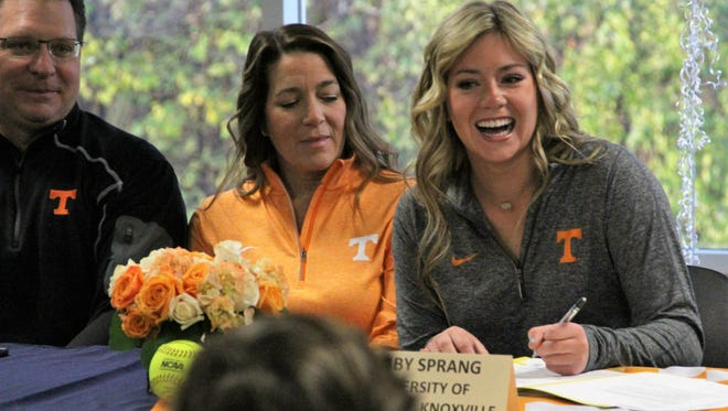 Gabby Sprang, right, signed her National Letter of Intent to play softball for Tennessee on Wednesday at Rosemount High School. Sprang was joined by her dad Brad, left, and mom Heidi.