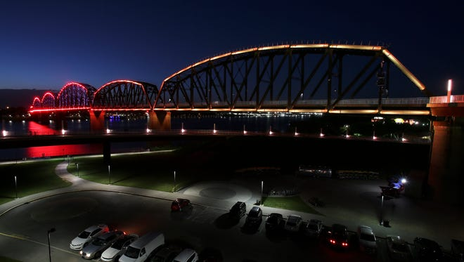 The Big 4 Bridge briefly flashed remnants of red and gold as it alternated through several colors on June 6, 2016. The red and gold were in honor of Muhammad Ali to symbolize the color of his gold medal and red gloves.