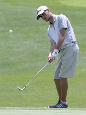 Trevor DeRoy chips onto the first green during the final round of the of the Schorsten Memorial Junior Golf Tournament at The Sanctuary Golf Club on Tuesday, July 21, 2020.