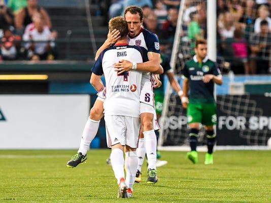 636393836620169310-Gerardo-Torrado-celebrates-a-goal-with-Brad-Ring---Photo-credit-New-York-Cosmos.jpg