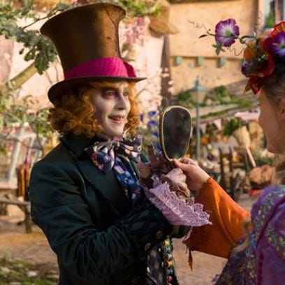 Johnny Depp, left, and Mia Wasikowska in a scene from