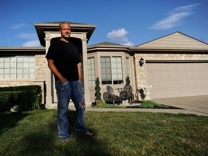 Eric Roos, a design sculptor for General Motors, stands