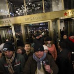 Eager shoppers crowd the entrance as they pour into the Macy's Herald Square flagship store in New York in 2013. Macy's Inc. on Monday said it plans to hire about 85,000 seasonal workers for temporary jobs ahead of the holidays.