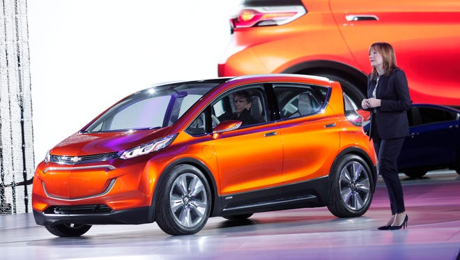 General Motors CEO Mary Barra reveals the new Chevrolet Bolt electric concept to the media at the 2015 North American International Auto Show
