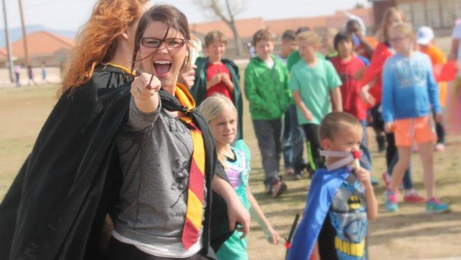 Ashley Schreffler, an educational assistant at Holloman Elementary School, dawns a Hogwarts uniform from the Harry Potter Series by JK Rowling.