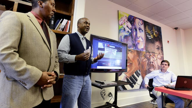 Tony Garrett, with CrimeStoppers, left, and Boyd Stephens, with revolutionMGM, announce the new website and social media push by CrimeStoppers at Ampersand Co-working space on Wednesday December 10,  2014 Montgomery, Ala. At right is Shawn Kirkland, lead developer for the project.