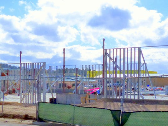 The large yellow building in the back is the new gymnasium to be shared.