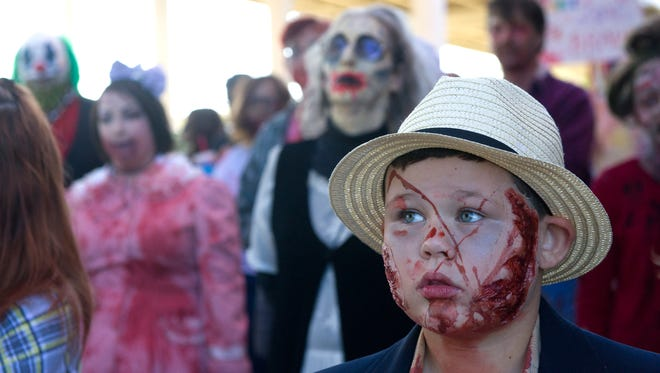 Seth Patty, 8, waits to begin the Knoxville Zombie walk at the Concourse at the International Saturday, Oct. 17, 2015. (JESSICA TEZAK/NEWS SENTINEL)