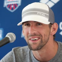 MESA, AZ - APRIL 25:  Michael Phelps speaks at a press conference after competing in the Men's 50m Freestyle prelim during day two of the Arena Grand Prix at the Skyline Aquatic Center on April 25, 2014 in Mesa, Arizona.  (Photo by Christian Petersen/Getty Images)