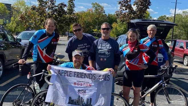 The Acton-based Team Apple Friends For ALS along with their inspiration and the event's top fundraising individual Steve Kowalski (third in front from right) who was diagnosed with ALS three years ago.