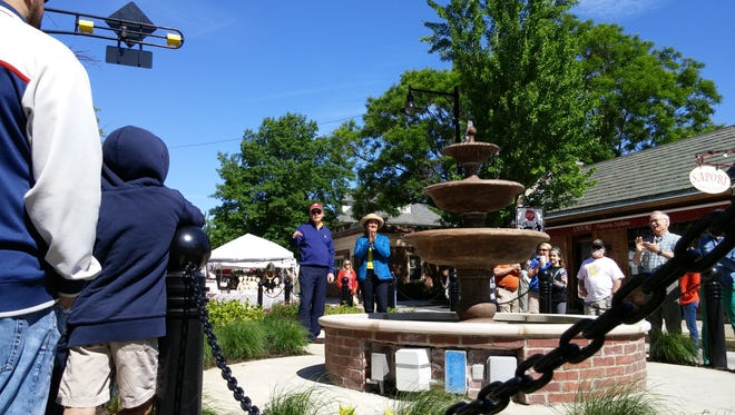 Onlookers applaud as Collingswood's fountain is formally turned on at Saturday's May Fair.