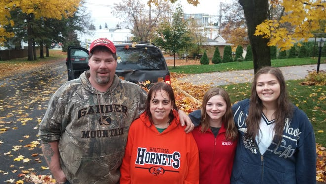 Eric Leeper, Pam Conway, Samantha Plante and Jamie Leeper pose for a photo after clearing the leaves from a Wausau yard on Make a Difference Day, Oct. 24, 2015.