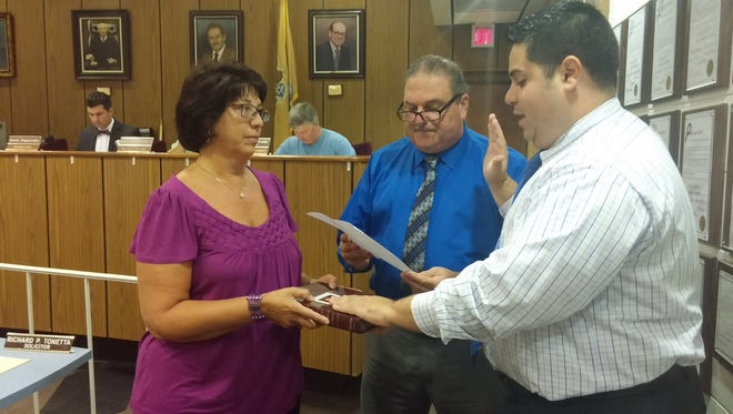 Anthony Zorzi takes oath of office from Mayor Joseph Baruffi (center) at the Sept. 28 Buena Borough Council meeting. Zorzi joined the borough Land Use Board as an alternate, taking a spot held briefly by his late father, Bret. Francesca Zorzi holds Bible for her son's oath.