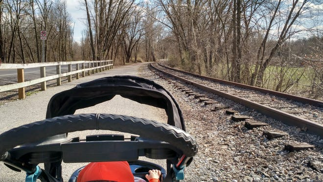 The view from behind the stroller on the York County Heritage Rail Trail.