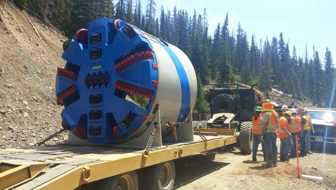 The cutting head of a tunnel boring machine is delivered to the Michigan Ditch tunnel work site near Cameron Pass.