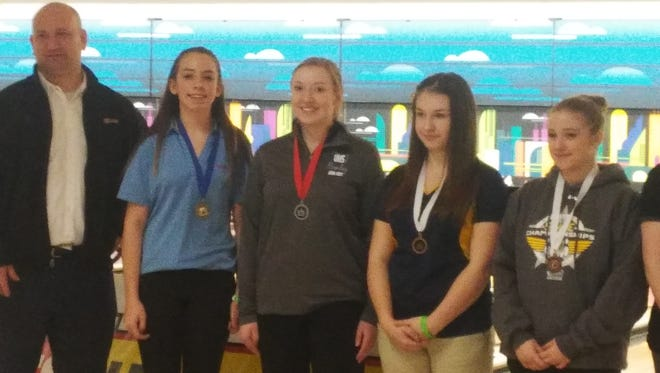 The top three finishers in the Class 2A girls state bowling championships, from left, Mark Morris' Brooklyn Boudreau, Olympic's Ashlyn Jamrog and Bremerton's Hannah Sutton. The individual championships were decided Thursday at Narrows Plaza in University Place, with the team titles determined Friday.