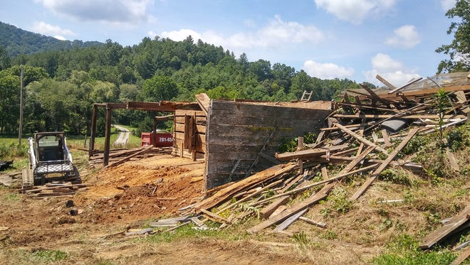 The barn, estimated to be roughly 230 years old,  is over halfway torn down three days into deconstruction on June 29.
