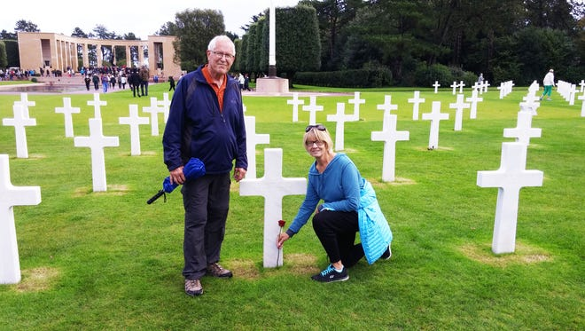 In 2015 while visiting the American cemetery on Normandy Beach, Marv and Julie Maass placed a rose at the foot of Iowa war correspondant George Bede Irvin's cross.