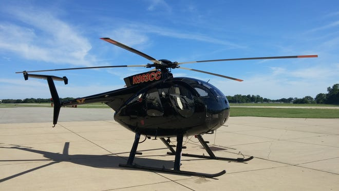 Met-Ed will use this black Hughes MD500 helicopter to conduct routine spring inspections of its transmission lines this week.