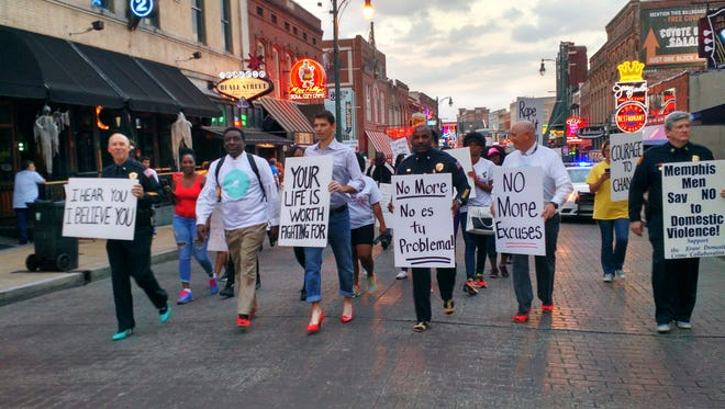 Men led the way west on Beale Street for the first Walk a Mile in Her Shoes in 2016 From left, MPD Deputy Chief Don Crowe, Judicial Commissioner Kevin Reed, City Council member Worth Morgan, MPD Lt. Colonel Keith Watson, Memphis COO Doug McGowen and MPD Deputy Director Mike Ryalls.